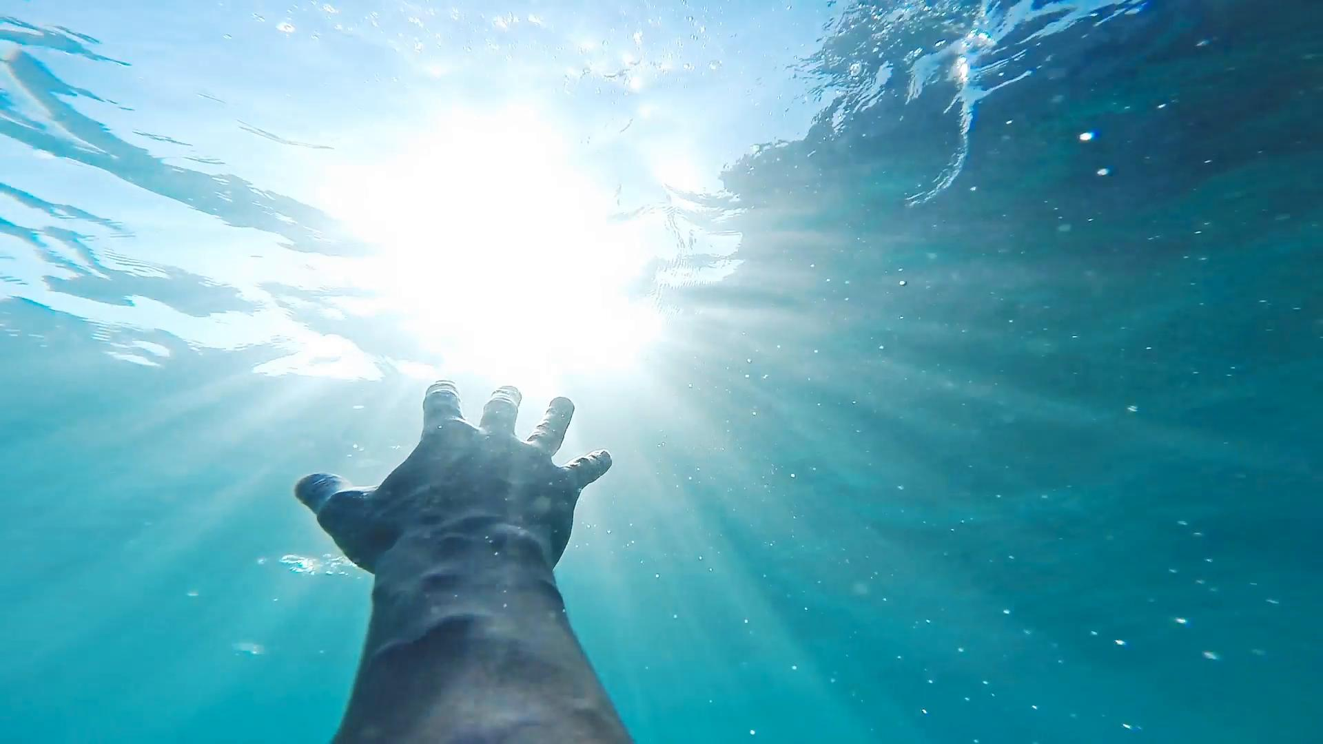 savior-rescuer-salvation-hand-man-drowning-saved-by-lifeguard-underwater-sun-shining-rescue-new-hope-second-chance-concept-gopro-hd_4yspe9-fz__F0000